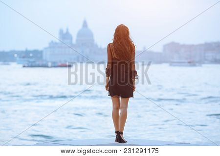 Travel Tourist Woman Standing On The Pier Against Beautiful View On Venetian Chanal With Boats In Ve