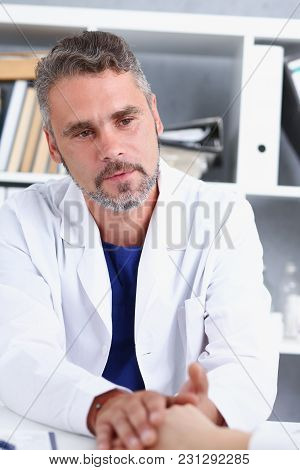 Friendly Male Doctor Hold Female Arm In Office During Reception Portrait. Examination Result Positiv