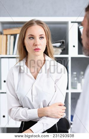 Concerned Female Visitor Portrait Talk With Doctor Filling History List At Pad. Physical Exam Trauma