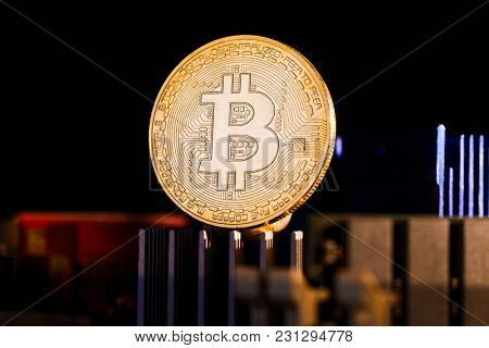 Picture of virtual currency, bitcoin and processor on orange background