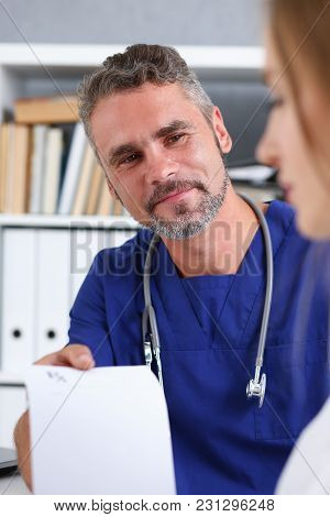 Male Medicine Doctor In Blue Uniform Hold And Give Prescription To Patient Closeup. Panacea And Life