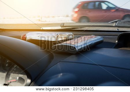 Alcoholic Drinks Lie Near The Windshield Of The Car.