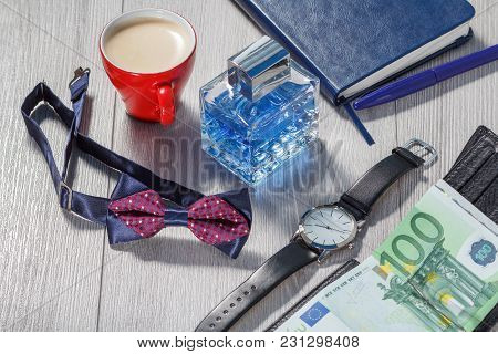 Man Perfume, Watch With A Black Leather Strap, Bow Tie, Notebook, Cup Of Coffee And Black Leather Wa