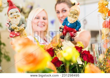 Florist woman selling rose bouquet to her female customer