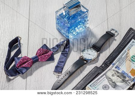 Man Perfume, Watch With A Black Leather Strap, Bow Tie And Black Leather Wallet With Dollar Bills On