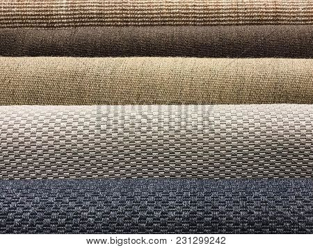 Samples Of Brown Woven Sisal, Blue And Gray Fiber Carpet Roll For Texture And Background