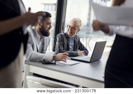 Business Colleagues Working Together In An Office