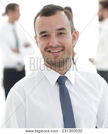 portrait of successful businessman on blurred background