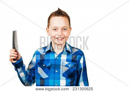Portrait Of A Little Boy Holding A Comb Isolated On White Background