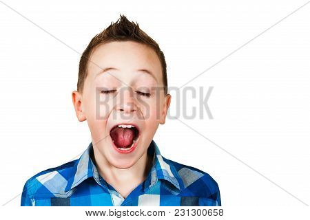 Close Up Portrait Of A Little Boy Screaming Out Loud Isolated Over Orange Background