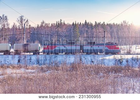 Freight Train At Cold Winter Morning Time.