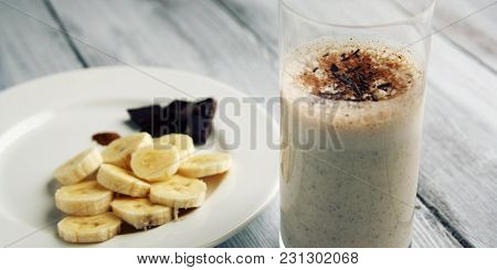 Banana Chocolate Smoothie With A Dash Of Cinnamon. Toned Photo. A Glass Of Milk Smoothie Sprinkled W
