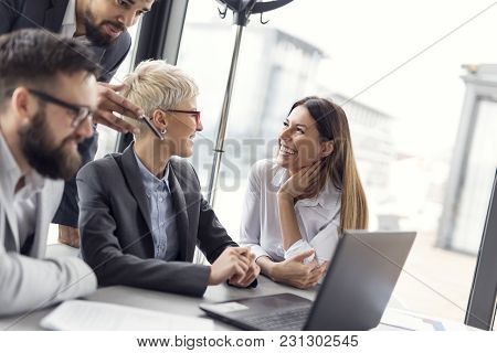 Group Of Business People Working Together. Focus On The Woman On The Right