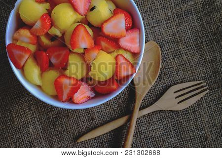 Strawberry And Watermelon Close Up With Wood Spoon.