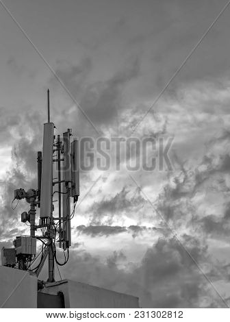 Antenna Of Gsm Transmitter On The Roof Of Building. Close Up. Black And White