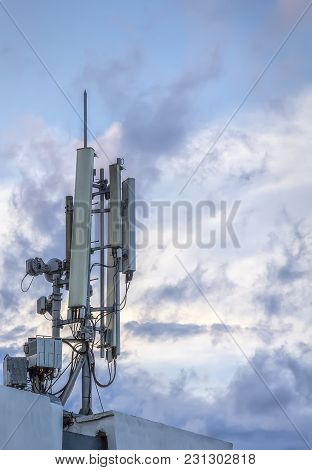Antenna Of Gsm Transmitter On The Roof Of Building. Close Up