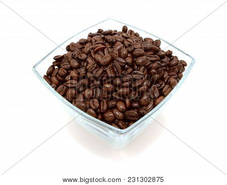 Glass Bowl Filled To The Brim With Coffee Beans