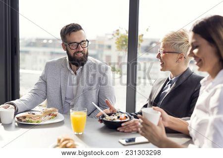 Business People Having Breakfast