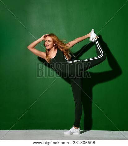 Woman Workout Exercising Stretching In Gym On Green Mint Wall Background With Sunlight. Diet Weight