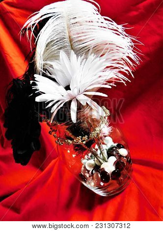 Flowers, Feathers, Glass Beads In Glass Jar Decor