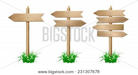 Set Of Wooden Signpost With Arrows In Grass Isolated On White Background. Vector Illustration