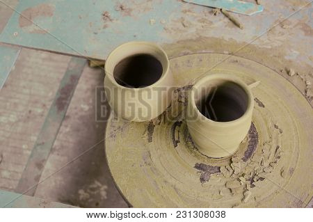 The Unfinished Brown Earthen Pots On Pedestal Sculpt
