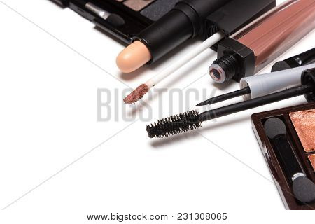 Beauty Products For Natural Day Makeup On White With Copy Space. Close-up, Selective Focus