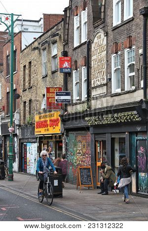 London, Uk - July 9, 2016: People Visit Brick Lane In Shoreditch, London. Shoreditch Is Known For It
