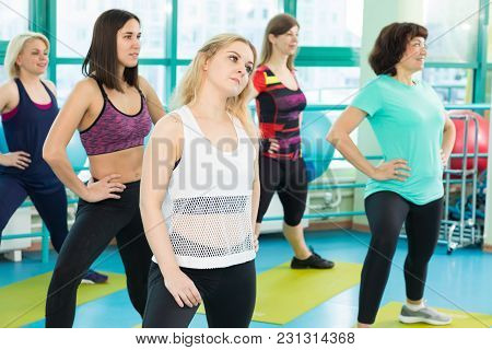 Three Females Doing Pilates Exercise In Sport Gym