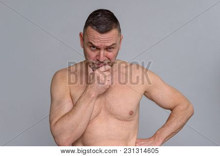 Naked Mature Man With A Suspicious Expression