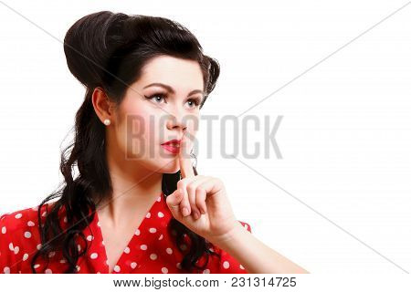 A Portrait Of A Beautiful Brunette With A Finger On Her Lips Showing To Keep Silence, Hush