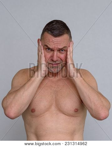 Portrait Of Naked Mature Man Looking Stressed