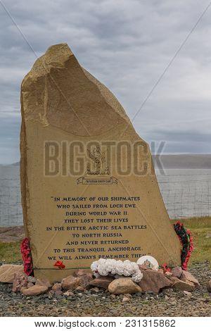 Inverasdale, Scotland - June 9, 2012: Closeup Of Memorial Rock-slab At Cove Light Anti Aircraft Batt