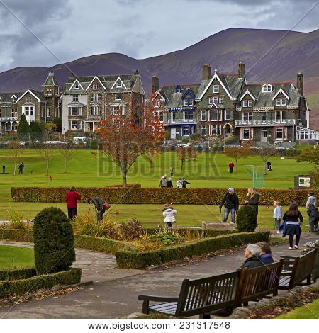 Tourists Enjoy The Scenic Lake District Town's Shops And Cafes.