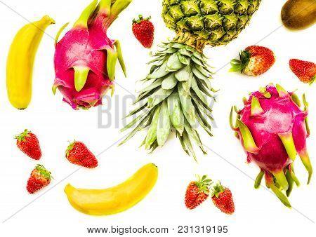 Tropical Fruit Background. Bananas, Strawberries, Pineapple, Kiwi And Dragonfruit Isolated On White