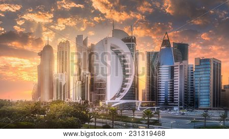 Doha, Qatar - December 17, 2017: The Skyline Of West Bay Of Doha City During Sunset. View From Shera