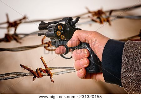 Detail Of Hand Holding A Charged Revolver