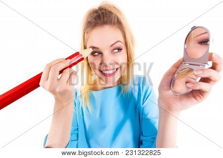 Funny Silly Woman Trying To Paint Her Eyebrows Using Big Huge Oversized Regular Student Pencil. Make