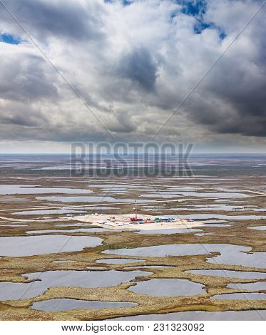 Aerial View Of Oilfield On Impassable Swamp Area.