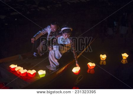 Hoi An , Vietnam - Oct 04 : Vietnamese Couple Dropping Lanterns Into The River In Hoi An , Vietnam D