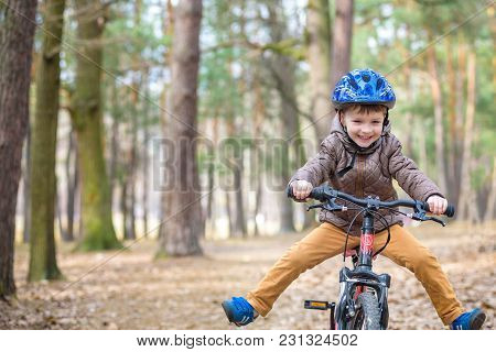 Happy Kid Boy Of 3 Or 5 Years Having Fun In Autumn Forest With A Bicycle On Beautiful Fall Day. Acti