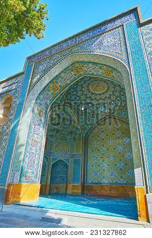 The Iwan (portal) Of Chaharbagh Madraseh Is Covered With Picturesque Islamic Patterns In Blue Gamma,