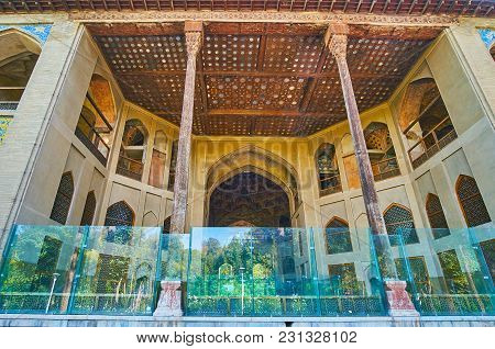 Isfahan, Iran - October 20, 2017: The  Summer Terrace Of Hasht Behesht Palace With Tall Timber Colum