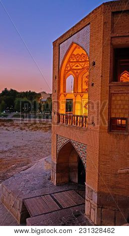 The Evening View From Khaju Bridge On Its Beautiful Portal With Scenic Arched Niches, Isfahan, Iran.