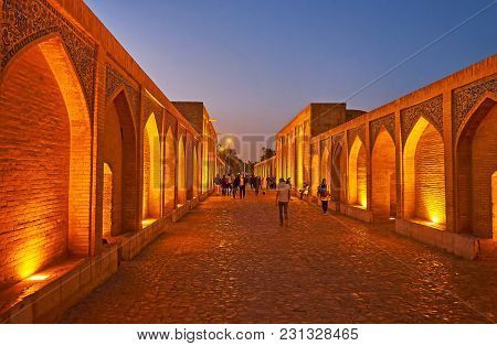 Isfahan, Iran - October 20, 2017: The Evening Walk Along The  Khaju Bridge With The View On Brick Ni