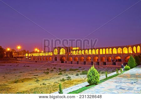 The Evening Walk In Moshtagh-e Aval Park, Stretching Along The Bank Of Zayandeh River, With A View O