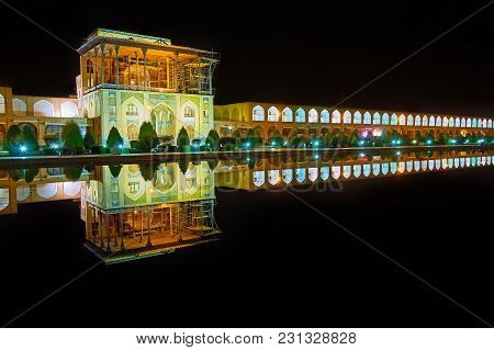 The Turned Off Fountain In The Middle Of Naqsh-e Jahan Square Serves As The Mirror, Reflecting  Brig