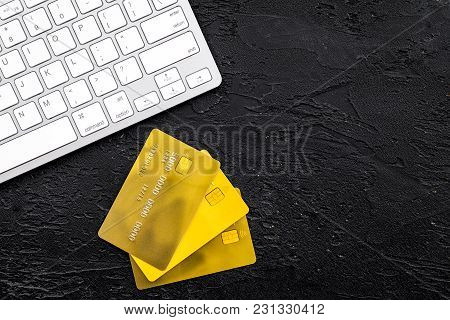 Electronic Payments. Bank Cards Near Keyboard Of Computer On Black Background Top View.