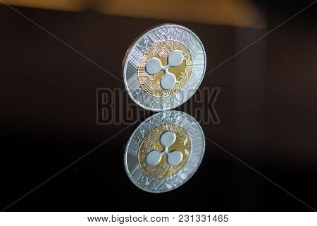 Ripple Cryptocurrency Coin On Black Mirror Background