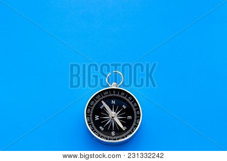 Compass On Blue Desk Background Top View Copy Space.